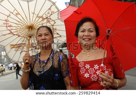 VANCOUVER, CANADA - AUGUST 12, 2012: Hundreds of costumed revellers took part in the Pinoy Fiesta, the annual Filipino Cultural Parade, in Vancouver, Canada, on August 12, 2012.  - stock photo
