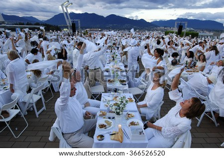 """VANCOUVER, CANADA - AUGUST 30, 2012: More than 1200 people, all dressed only in white, gathered for a flash mob picnic dinner event """"Diner en Blanc"""" on Aug.30, 2012 in Vancouver, Canada.  - stock photo"""