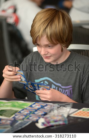 VANCOUVER, CANADA - AUGUST 10, 2013: Players compete during local Pokemon video games tournament in Vancouver, Canada, August 10, 2013. - stock photo
