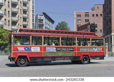 VANCOUVER, CANADA - AUGUST 6, 2005: Tour Trolley Bus driving on East Pender Street in Vancouver, Canada. Tourists enjoy a Vancouver Sightseeing Tour in a San Francisco-style Trolley. - stock photo