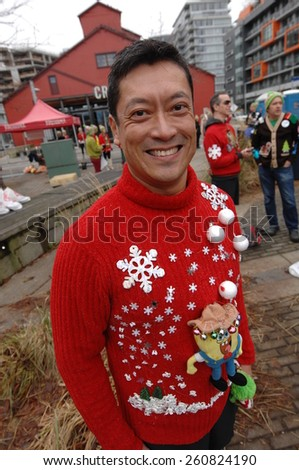 VANCOUVER, CANADA - DECEMBER 13, 2014: Hundreds of runners and walkers celebrated Christmas by participating in The Ugly Sweater Run 5K in Vancouver, Canada, on December 13, 2014.  - stock photo