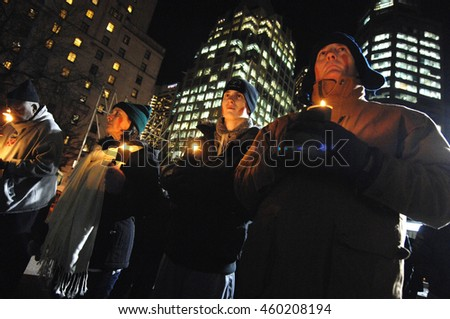 VANCOUVER, CANADA - DECEMBER 6, 2013: People attend a candlelight vigil for first black president of South Africa Nelson Mandela in Vancouver, Canada, Dec.6, 2013.  - stock photo