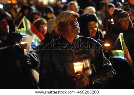 VANCOUVER, CANADA - DECEMBER 6, 2013: People attend a candlelight vigil for first black president of South Africa Nelson Mandela in Vancouver, Canada, Dec.6, 2013.
