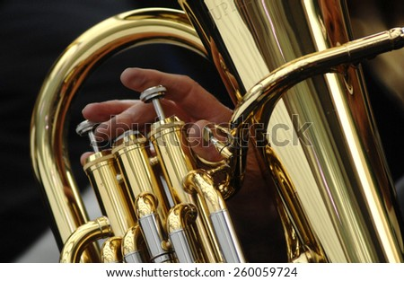 VANCOUVER, CANADA - DECEMBER 21, 2014: Tenor and bass tuba players perform Christmas carols during the 41st annual Tuba Christmas event at Robson Square in Vancouver, Canada, on December 21, 2014.  - stock photo