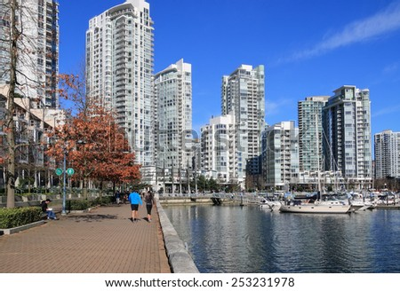 VANCOUVER, CANADA - FEBRUARY 15, 2015: Unidentified people enjoy sunny day in Yaletown. Formerly a warehouse district, Yaletown is one of the most densely populated neighborhoods in the city. - stock photo