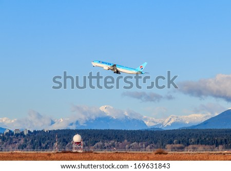 VANCOUVER, CANADA - JANUARY 03, 2014: Korean Air airplane takes off in Vancouver International Airport. Korean Air Lines Co. is both the flag carrier and the largest airline of South Korea