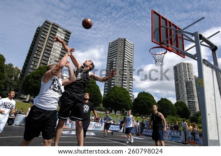 VANCOUVER, CANADA - JULY 29, 2012: Athletes play street basketball at Sunset Beach in Vancouver, Canada, on July 29, 2012. - stock photo