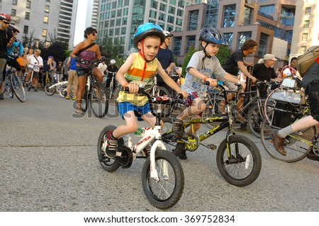 VANCOUVER, CANADA - JULY 27, 2012: Hundreds of bicycle enthusiasts took to the streets to promote the environmentally friendly modes of transportation on July 27, 2012 in Vancouver, Canada. - stock photo