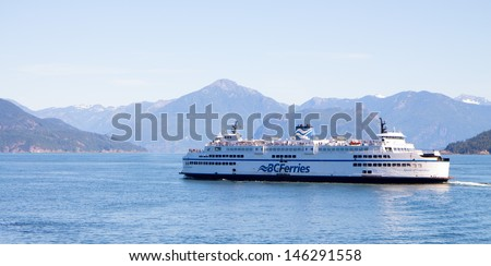 VANCOUVER, CANADA-JULY 15 2013: One of British Columbia ,Canada's commuter and tourist ferries that transports cars and people on July 15, 2013 in Vancouver, British Columbia,Canada