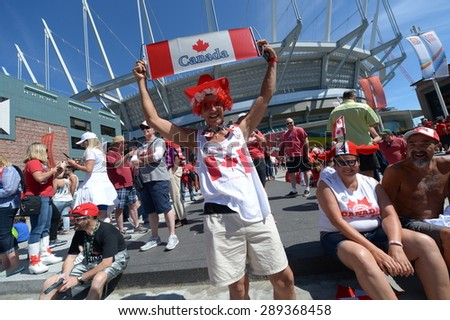 VANCOUVER, CANADA - JUNE 21, 2015: Canadian fans arrive to BC Place Stadium for FIFA Women's World Cup Canada 2015 matches in Vancouver, Canada, on June 21, 2015. - stock photo