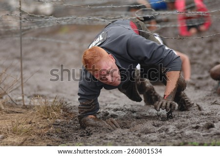 VANCOUVER, CANADA - JUNE 1, 2013: Competitors participate in the 2013 Spartan Race obstacle racing challenge in Vancouver, Canada, on June 1, 2013.