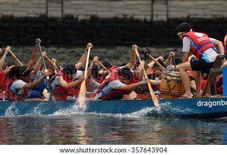 VANCOUVER, CANADA - JUNE 23, 2013: Rowers participate in the annual Rio Tinto Alcan Dragon Boat Festival and Race on June 23, 2013 in Vancouver, Canada.  - stock photo
