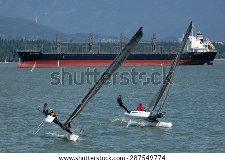 VANCOUVER, CANADA - JUNE 14, 2015: Sailors take part in a local races at English Bay in Vancouver, Canada, June 14, 2015.