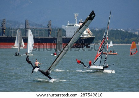 VANCOUVER, CANADA - JUNE 14, 2015: Sailors take part in a local races at English Bay in Vancouver, Canada, June 14, 2015.  - stock photo