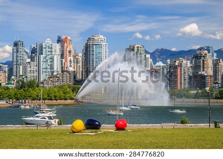 VANCOUVER, CANADA - JUNE 05, 2015: Unidentified people watch False Creek pump station test in Vancouver. Pump station supplies water for firefighting purposes via a network of water mains and hydrants - stock photo