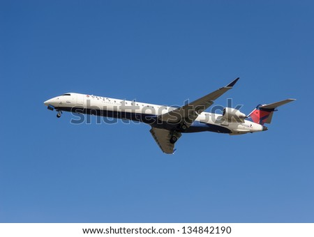 VANCOUVER, CANADA - MARCH 28: Delta Airlines Bombardier  aircraft on final approach to Vancouver International Airport on March 28, 2013. Delta is the world's largest airline.