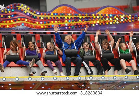 VANCOUVER, CANADA - MARCH 16, 2013: Kids and their families enjoy the ride at the PlayDome, a carnival-style amusement park, in Vancouver, Canada, Mar.16, 2013. - stock photo