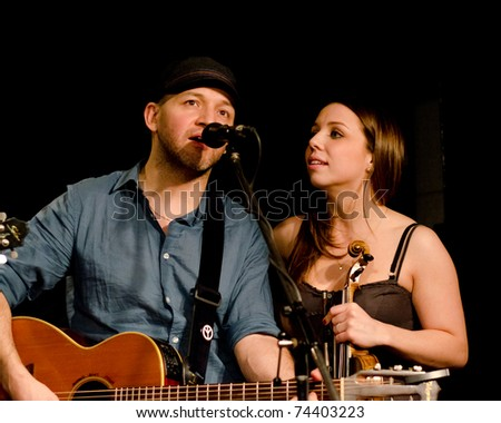 VANCOUVER, CANADA - MARCH 27: Trio Starbirds. Kalissa Hernandez and Tom Landa on the stage of The Jazz Cellar on March 27, 2011 in Vancouver, Canada. - stock photo
