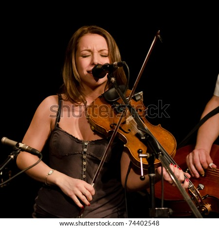 VANCOUVER, CANADA - MARCH 27: Trio Starbirds. Kalissa Hernandez on the stage of The Jazz Cellar on March 27, 2011 in Vancouver, Canada. - stock photo