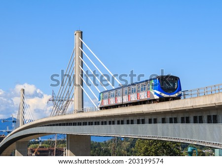 VANCOUVER, CANADA - MAY 30, 2014: Canada Line train passes bridge on May 30, 2014. The Canada Line is Vancouver new rapid transit rail link connecting airport to downtown Vancouver. - stock photo