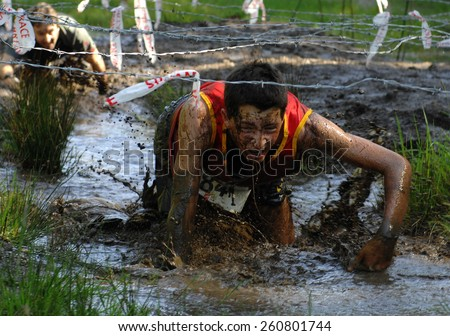 VANCOUVER, CANADA - MAY 12, 2012 : Competitors participate in 2012 Spartan Race obstacle racing challenge in Vancouver, Canada, on May 12, 2012. - stock photo
