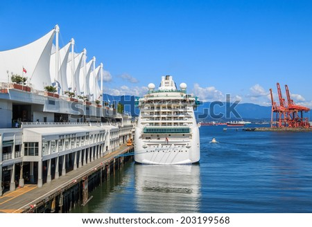 "VANCOUVER, CANADA - MAY 30, 2014: Cruise ship ""Radiance of the Seas"" at Canada Place Harbor on May 30, 2014 in Vancouver. Canada Place, Canada's inspiring national landmark, opened in 1986. - stock photo"