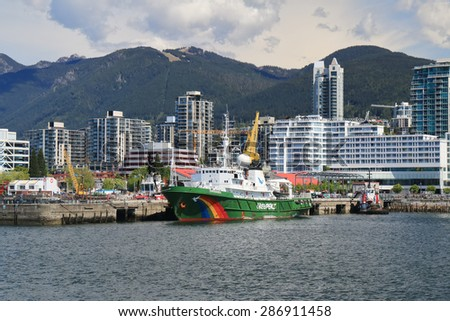 VANCOUVER, CANADA - May 07, 2015: Greenpeace Esperanza vessel is moored at the dock in North Vancouver. At 72 meters length, and a top speed of 16 knots, the ship is ideal for fast and long range work - stock photo