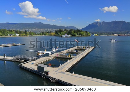 VANCOUVER, CANADA - May 07, 2015: Row of seaplanes at Vancouver Harbour Flight Centre. Centre is conveniently located for travelers, with immediate access to Vancouver business district and hotels. - stock photo