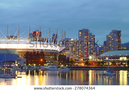 VANCOUVER, CANADA: MAY 1, 2013 : View of the BC Place stadium and the Rogers Arena from False Creek. - stock photo