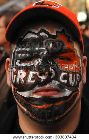 VANCOUVER, CANADA, NOVEMBER 27, 2011:  Football fans arrive to BC Place to watch BC Lions playing Winnipeg Blue Bombers in Grey Cup final game in Vancouver, Canada, Nov.27, 2011.  - stock photo