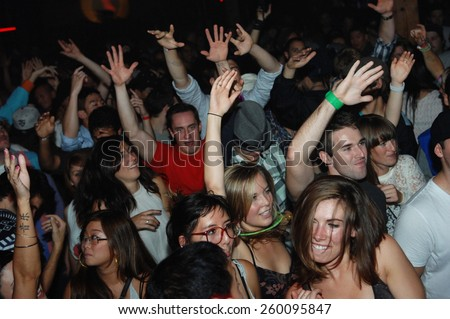 VANCOUVER, CANADA - OCTOBER 5, 2011: Clubgoers enjoy the atmosphere of a nightclub in Vancouver, Canada, on October 5, 2011.