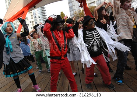 VANCOUVER, CANADA - OCTOBER 27, 2012: Hundreds of people gathered to perform Michael Jackson's Thriller as part of worldwide Thrill The World 2012 event in Vancouver, Canada, Oct.27, 2012.