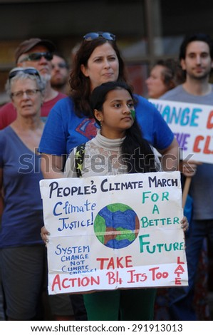 VANCOUVER, CANADA - SEP. 21, 2014: Thousands of people took part in the People's Climate March calling world leaders' attention to global warming, Vancouver, Canada, on Sep. 21, 2014.
