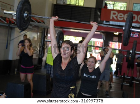 VANCOUVER, CANADA - SEPTEMBER 10, 2011: Athletes show their strength during public event to promote CrossFit sports training in Vancouver, Canada, September 10, 2011. - stock photo