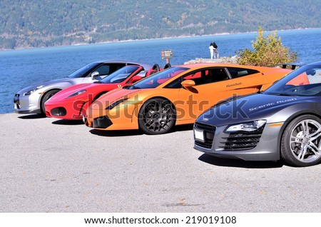 VANCOUVER, CANADA - SEPTEMBER 20: Exotic super cars Audi R8 Lamborghini Gallardo Ferrari and Nissan GTR from the club scenic rush in Vancouver on September 20, 2014. - stock photo