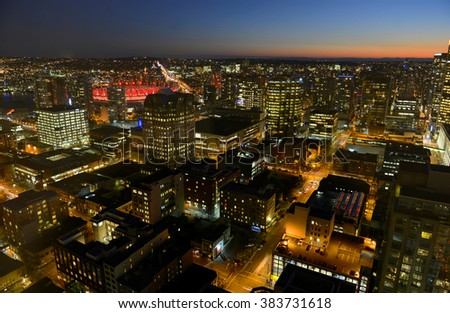 Vancouver city financial district at night, photo taken from the Harbour Centre tower, Vancouver, British Columbia, Canada. - stock photo