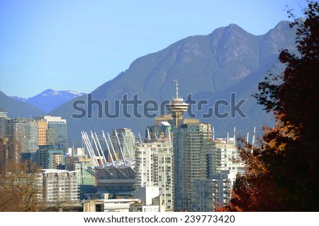Vancouver city skyline and Harbour Centre Tower with Mount Fromme at the background, Vancouver, British Columbia, Canada. - stock photo