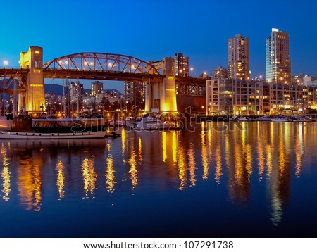 Vancouver cityscape at night. Colorful city night with skyscrapers and marina with boats. - stock photo