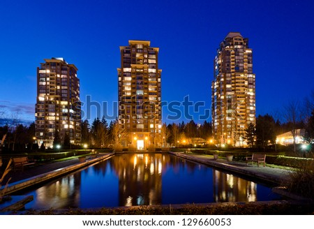 Vancouver cityscape at night. Colorful city night with skyscrapers, highrise buildings.