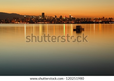 Vancouver Dawn Cityscape. A twilight morning view of downtown Vancouver across English Bay. British Columbia, Canada. - stock photo