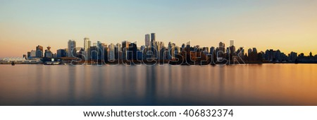 Vancouver downtown architecture and boat with water reflections at sunset panorama - stock photo