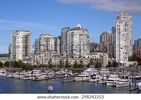 VANCOUVER - JULY 2015:  Closeness to water is one of the attractions of this city, and people pay a premium for these waterfront apartments seen in Vancouver in July 2015.