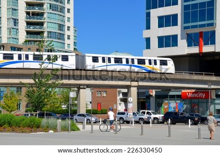 VANCOUVER - JULY 28: Downtown Vancouver Skytrain Transportation on July 28, 2014 in Vancouver, Canada. Vancouver great accessibility for visitors, it is the third largest city in Canada. - stock photo