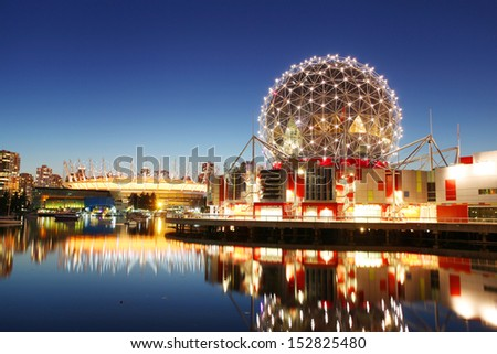 VANCOUVER - JULY 21: Science World and BC Place Stadium in Vancouver, Canada on July 21, 2013. Vancouver has been ranked the third most liveable city in the world for the second year in a row. - stock photo