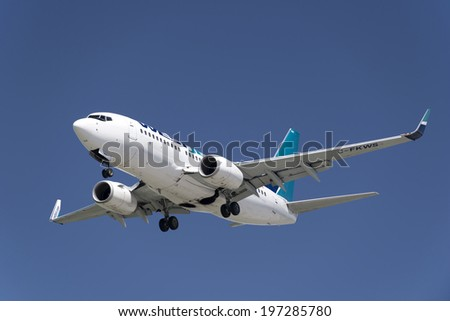 VANCOUVER - JUNE 7, 2014: WestJet, the second largest Canadian carrier founded 1996, transports passengers to 89 destination in Caribbean, North and Central America and Europe. Boeing 737-700 by YVR - stock photo