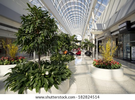 VANCOUVER - MARCH 20, 2014: Vancouver's most stylistic shopping mall, the Oakridge Centre is located at the intersection of Cambie Street and 41st Ave. Mall was  opened in 1959 by Woodward's Stores. - stock photo