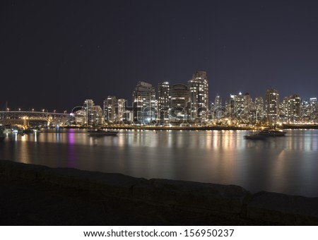 Vancouver Skyline and Sailboats in False Creek Harbour, Vancouver, British Columbia, Canada.