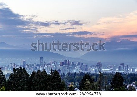 Vancouver skyline at dusk as seen from Queen Elizabeth Park, British Columbia, Canada