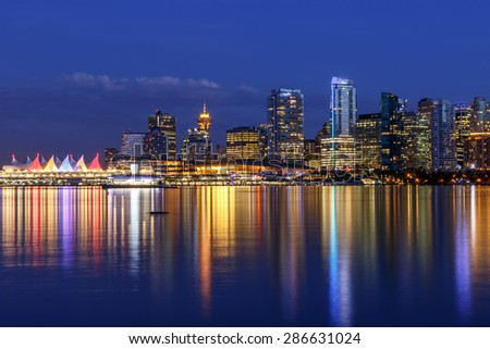 Vancouver skyline at Dusk as seen from Stanley Park, British Columbia, Canada - stock photo