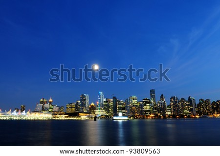 Vancouver skyline at night by full moon - stock photo